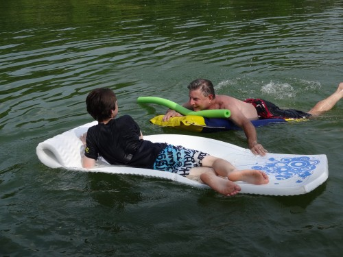 Two people, two floaty toys. One person about to get wetter.
