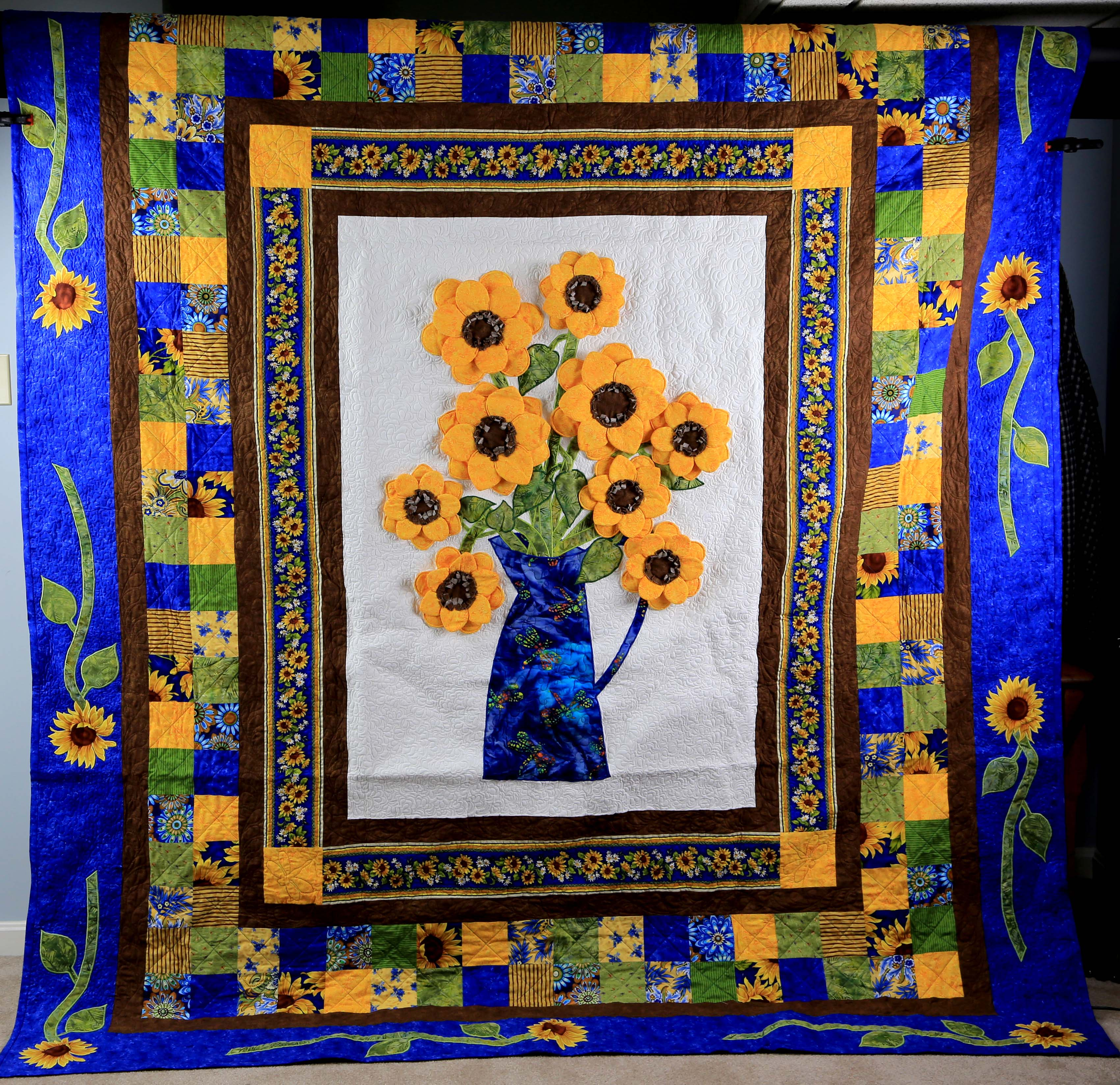 Shaking out the Sunflower Quilt
