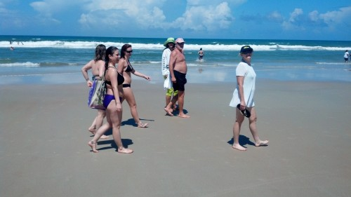 group walking on the beach