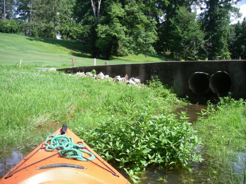 kayak nose on golf course at cart path bridge
