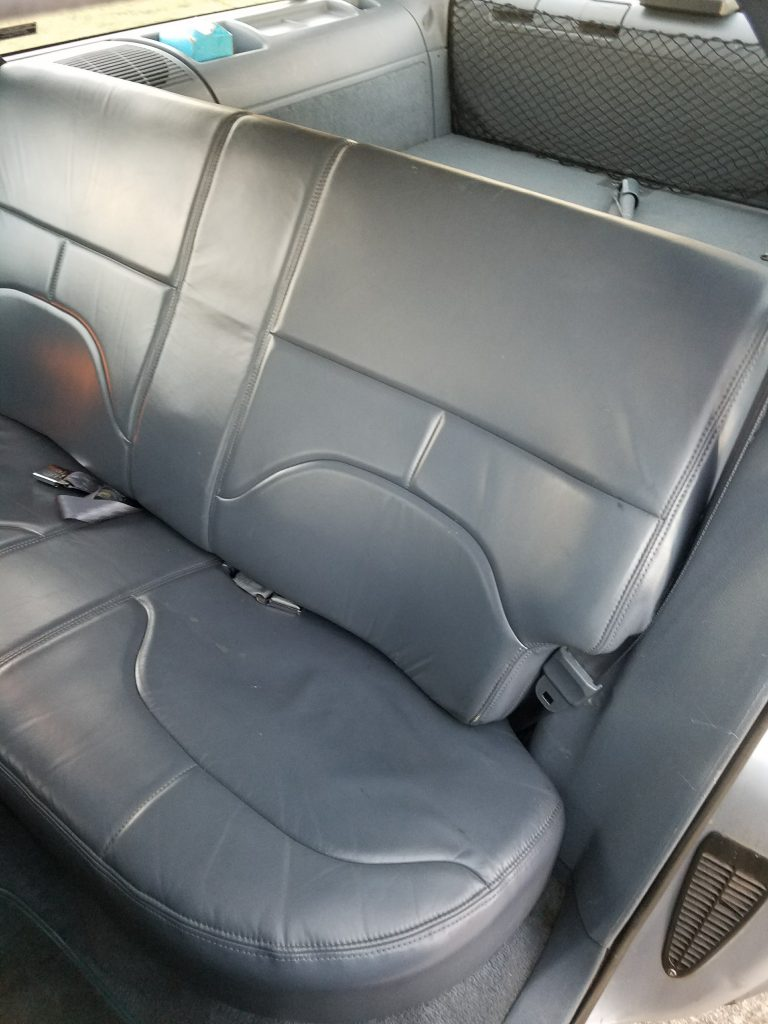 The middle row seat easily folds down.
